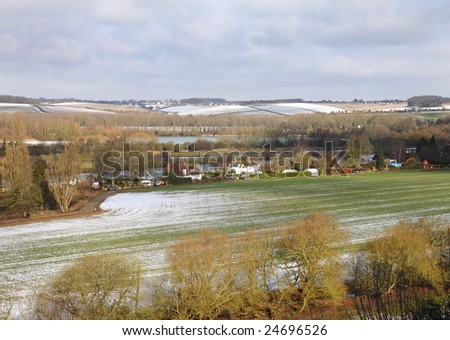 An English Landscape in Winter with frost and snow on the fields