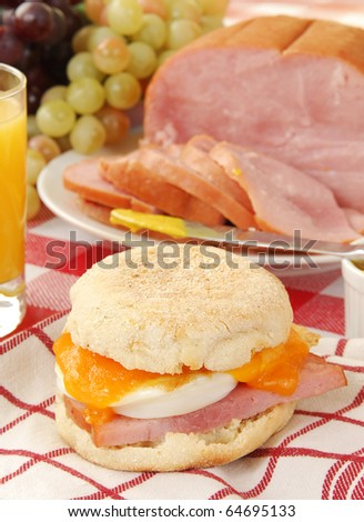 An English Muffin with ham, cheddar cheese and a fried egg