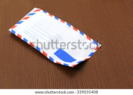 an envelope on wooden ground