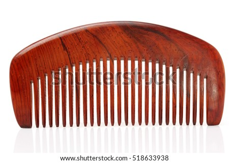 An ethnic wooden comb on a white background.