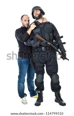 an evil villain threatening a swat officer with a gun - stock photo