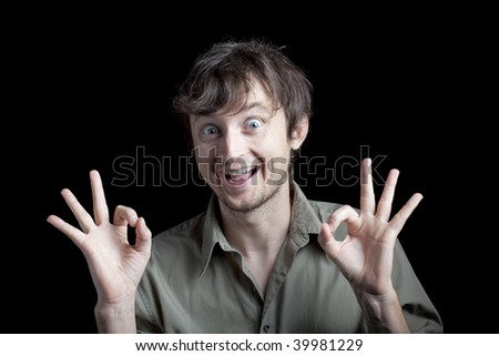 An excited man making a hand gesture