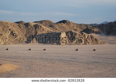 An excursion by ATV to the Bedouins' village through the desert in Egypt