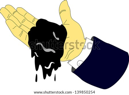 An executive hand holds a small amount of petrol and it drips from his hand.