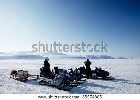 An expedition over a polar winter landscape with frozen ice