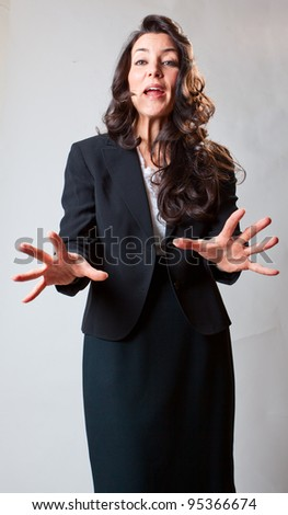 An expressive business woman explaining an issue - stock photo