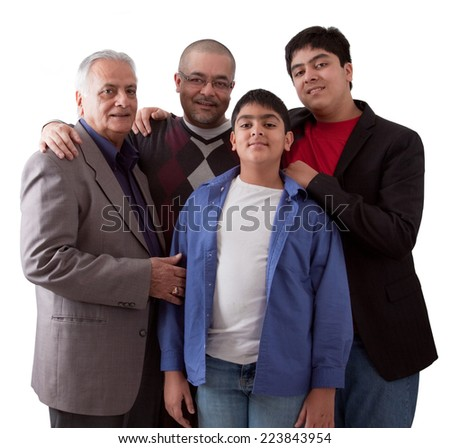 An extended Indian family of grandfather, son and grandsons in a studio setting
