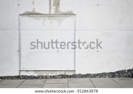 An exterior stone wall with moisture patches - stock photo
