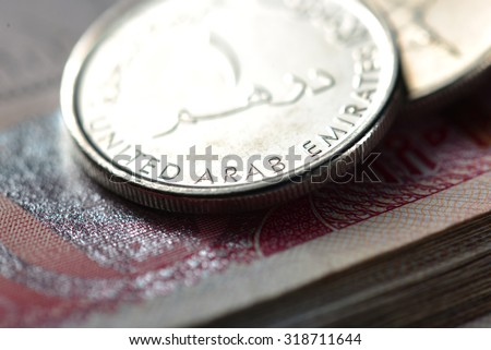 An extreme close up and details of One UAE dirham coin. - stock photo