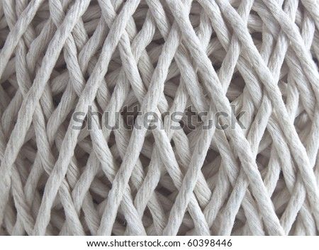 an extreme close up of a ball of string texture - stock photo