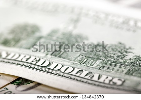 An extreme close up of the reverse side of a 100 US$ money note, with very shallow depth of field. Focus on the 'D' and 'O'. - stock photo