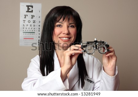 An eye doctor holding a pair of eye test trial  frames