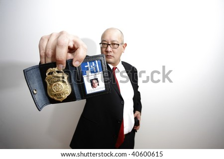 An FBI agent with a badge.