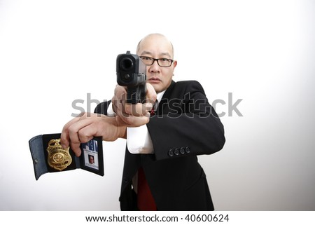 An FBI agent with a badge and gun.