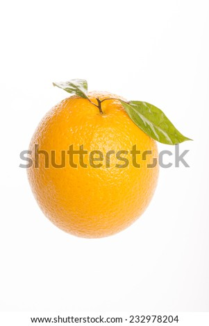 An fresh orange with leaf isolated on white background