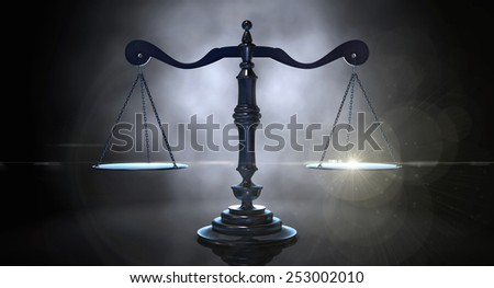 An gold justice scale backlight an an eerie dark background - stock photo