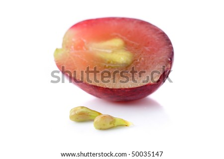 An half grape with seeds isolated over white background.