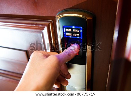 An hand is going to open a door. - stock photo