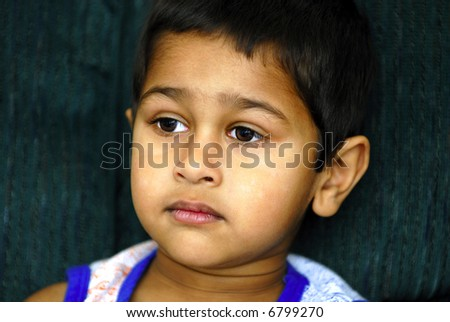 An handsome boy engrossed watching television - stock photo