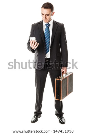an handsome businessman with a smartphone isolated over a white background