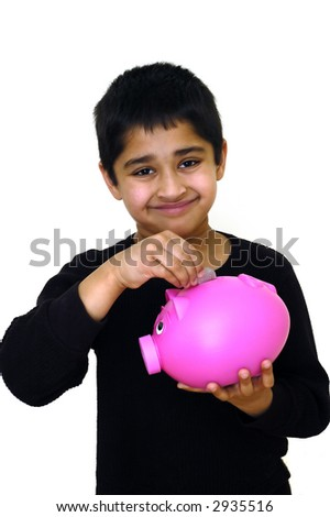 An handsome child saving money illustrating the saving concept