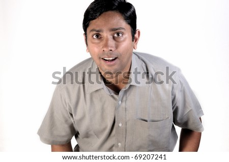 An handsome Indian businessman looking very excited - stock photo