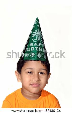 An handsome Indian kid celebrating happy birthday - stock photo