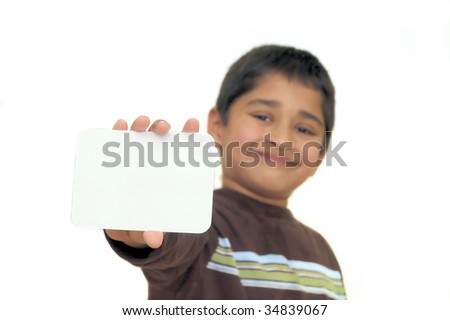 An handsome Indian kid holding a signboard - stock photo