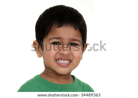 An handsome Indian kid irritated at something - stock photo