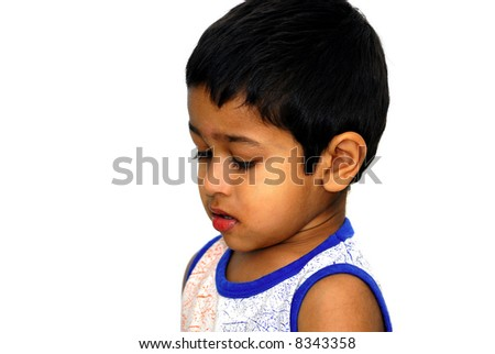 An handsome Indian kid looking very disappointed - stock photo
