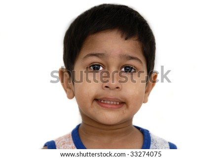 An handsome Indian kid looks very pissed off - stock photo