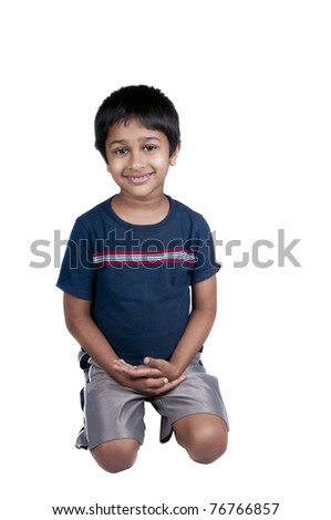An handsome Indian kid practicing Yoga - stock photo