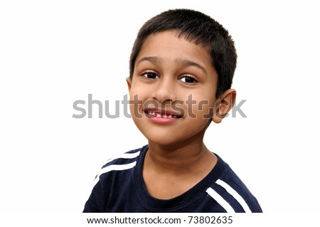 an handsome indian kid smiling for you - stock photo