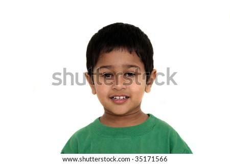 An handsome Indian kid smiling nicely for you