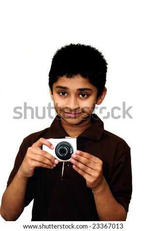 An handsome Indian kid taking photo with a digital camera