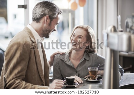 an handsome man meets  a beautiful woman in a cafe - stock photo