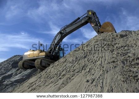 An heavy construction excavator at site work. - stock photo