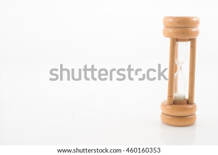 An hour glass over a white background