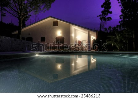 an house with a pool located at Algarve, Portugal - stock photo