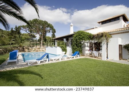 an house with a pool located at algarve, south of portugal - stock photo