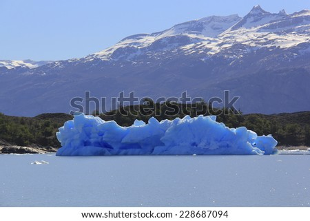 An iceberg calved from Upsala glacier floating in the Argentino Lake.  This is one of the available visits at El Calafate, Santa Cruz, Patagonia Argentina.  - stock photo