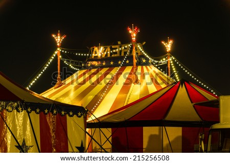 An illuminated big top at night with the nigh sky at background - stock photo