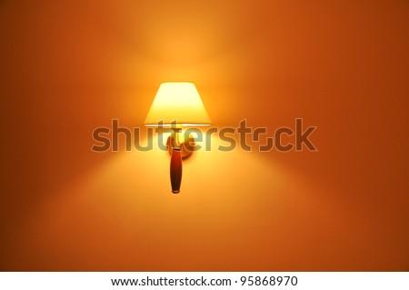 An illuminated lamp on the wall - stock photo