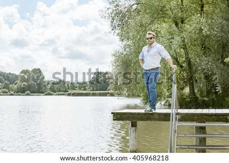 An image of a bearded man at the lake - stock photo