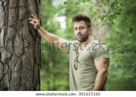 An image of a bearded man in the woods - stock photo