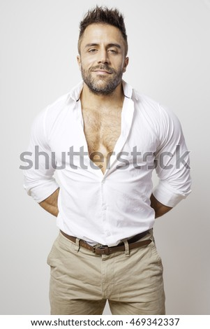 An image of a bearded man open shirt