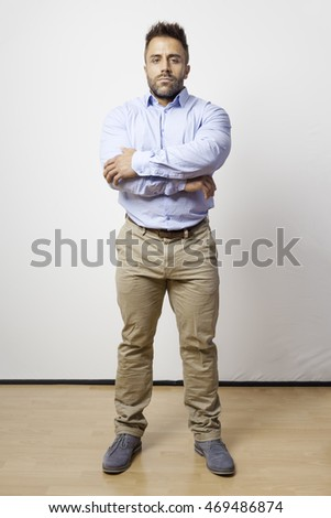 An image of a bearded man standing