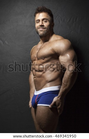 An image of a bearded muscular man