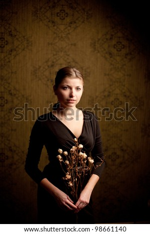An image of a beautiful girl with dried flowers