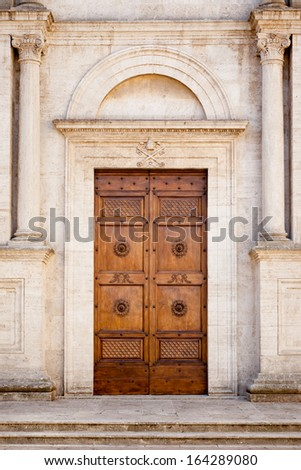 An image of a beautiful wooden door in Pienza Italy - stock photo